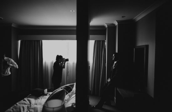 photographer taking photo of groom